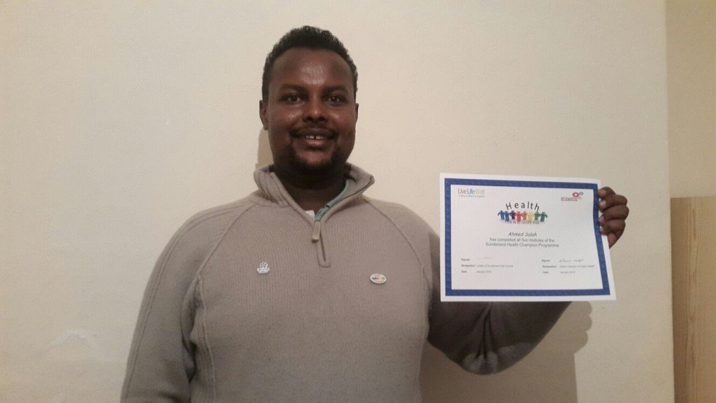 Ahmed showing his Health Champion certificate