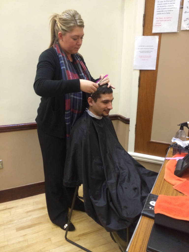 Yousef having his hair cut at the Drop- In