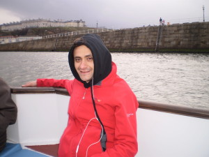 ANAS WRAPPED UP WARM ON THE BOAT